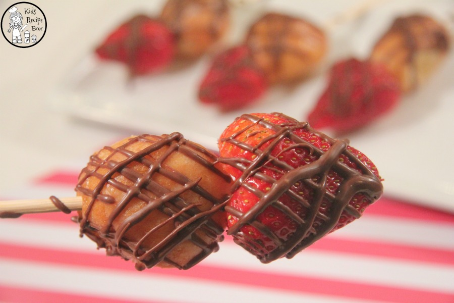 Easy Cupid's Arrow Valentine's Day Dessert Sticks with strawberries and donut holes.