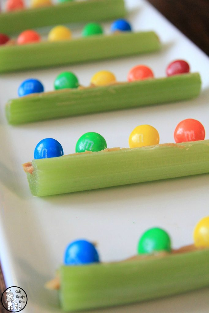 Peanut Butter M&Ms Celery Boats Rainbow Snack for kids.